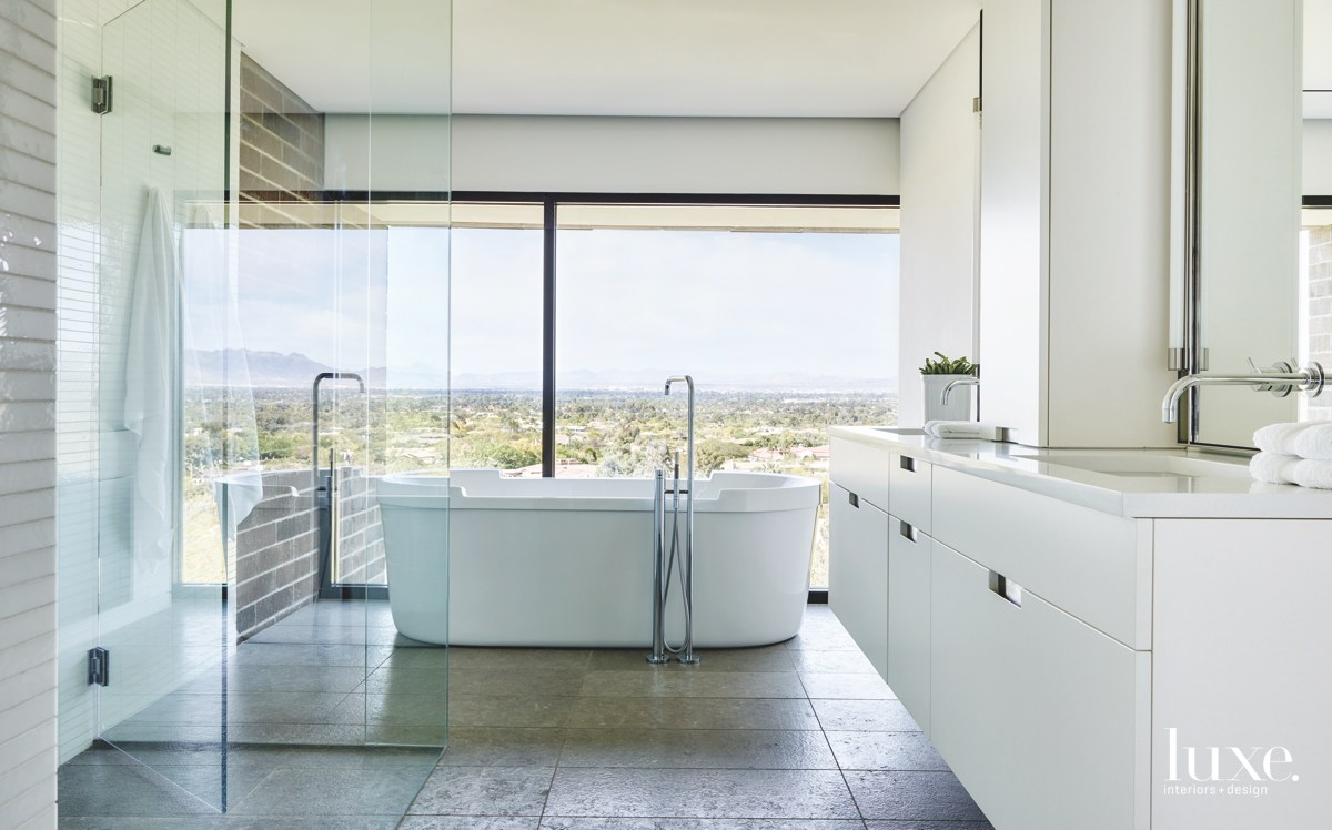 contemporary bathroom white floor-to-glass ceiling