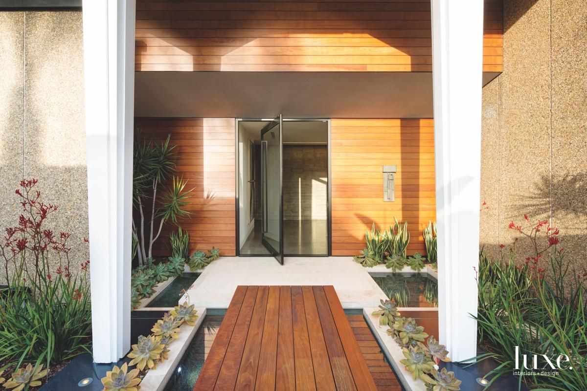 modern exterior entry pivoting door...