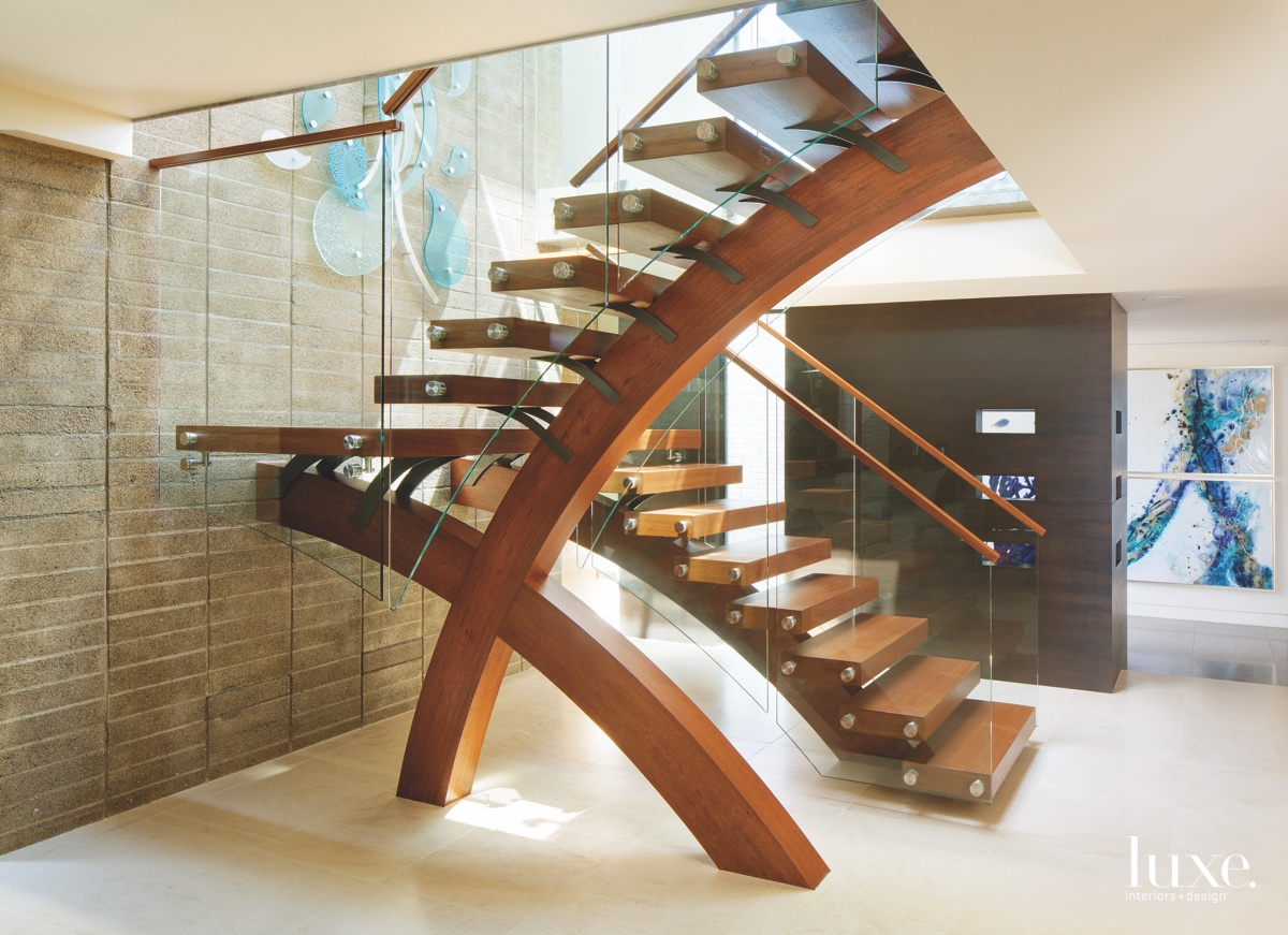 modern entry curved sculptural staircase