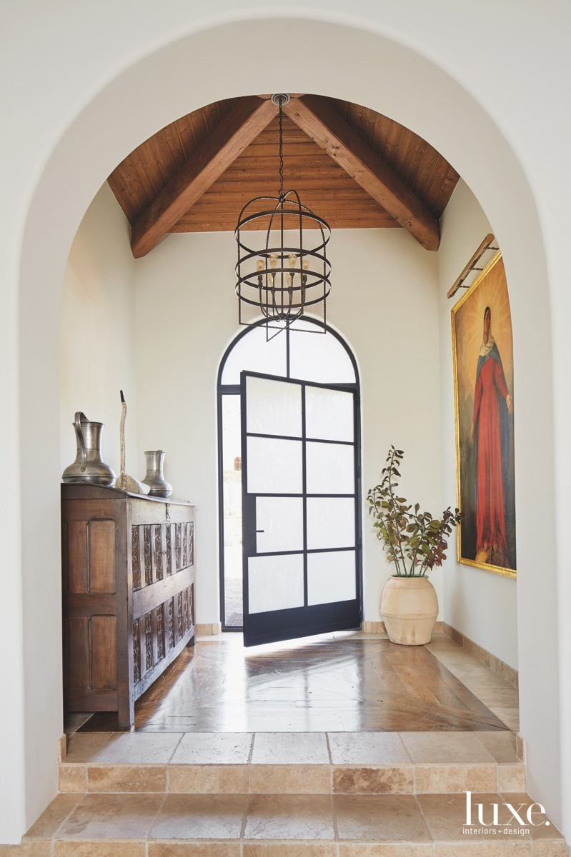traditional entry iron-framed frosted-glass door