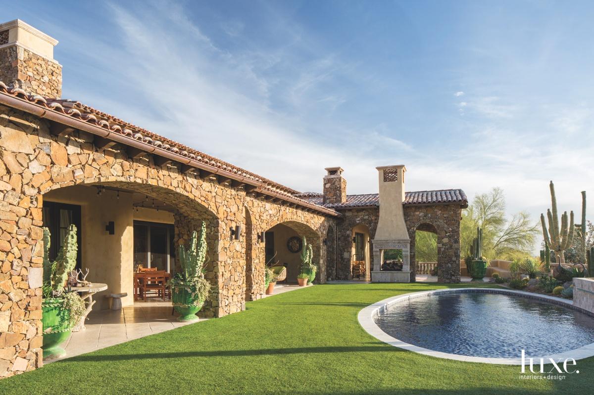 traditional backyard landscape pool