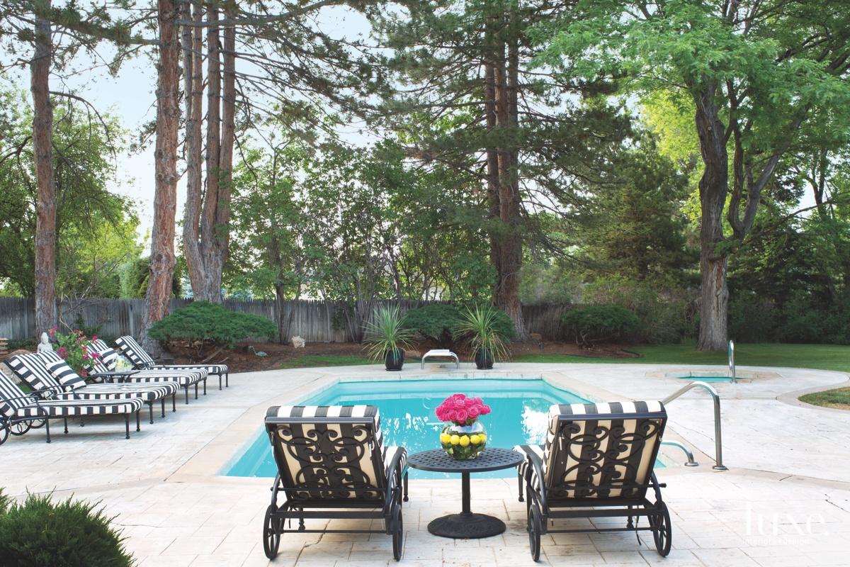 modern backyard pool black and...