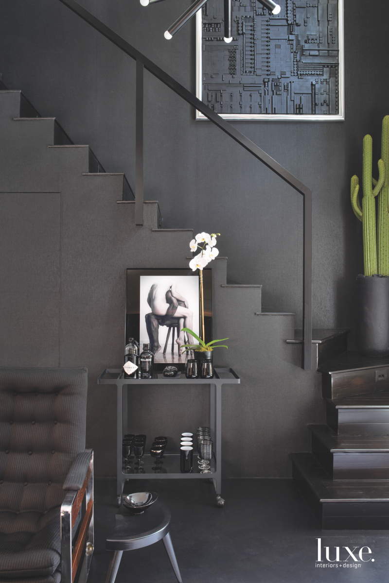 contemporary black stairwell black chair