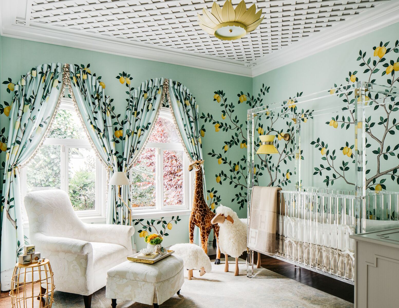 The youngest member of that fictional family lives in a luxurious nursery created by Dina Bandman. The designer crafted an infant's room that eschews pink and blue colors in favor of yellow and mint hues. High notes include a custom Lucite crib and a De Gournay wallpaper featuring lemon trees (some of fruit is hand-embellished with sequins).