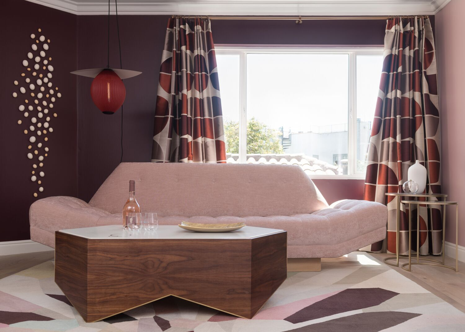 If you plan on taking selfies in this house, best to pose in the Rose Lounge by Melanie Coddington, because the blush and wine colors on the walls make your skin glow. The designer calls the room feminine, but there's also an edge in pieces like the black patent leather handbag with a flashing