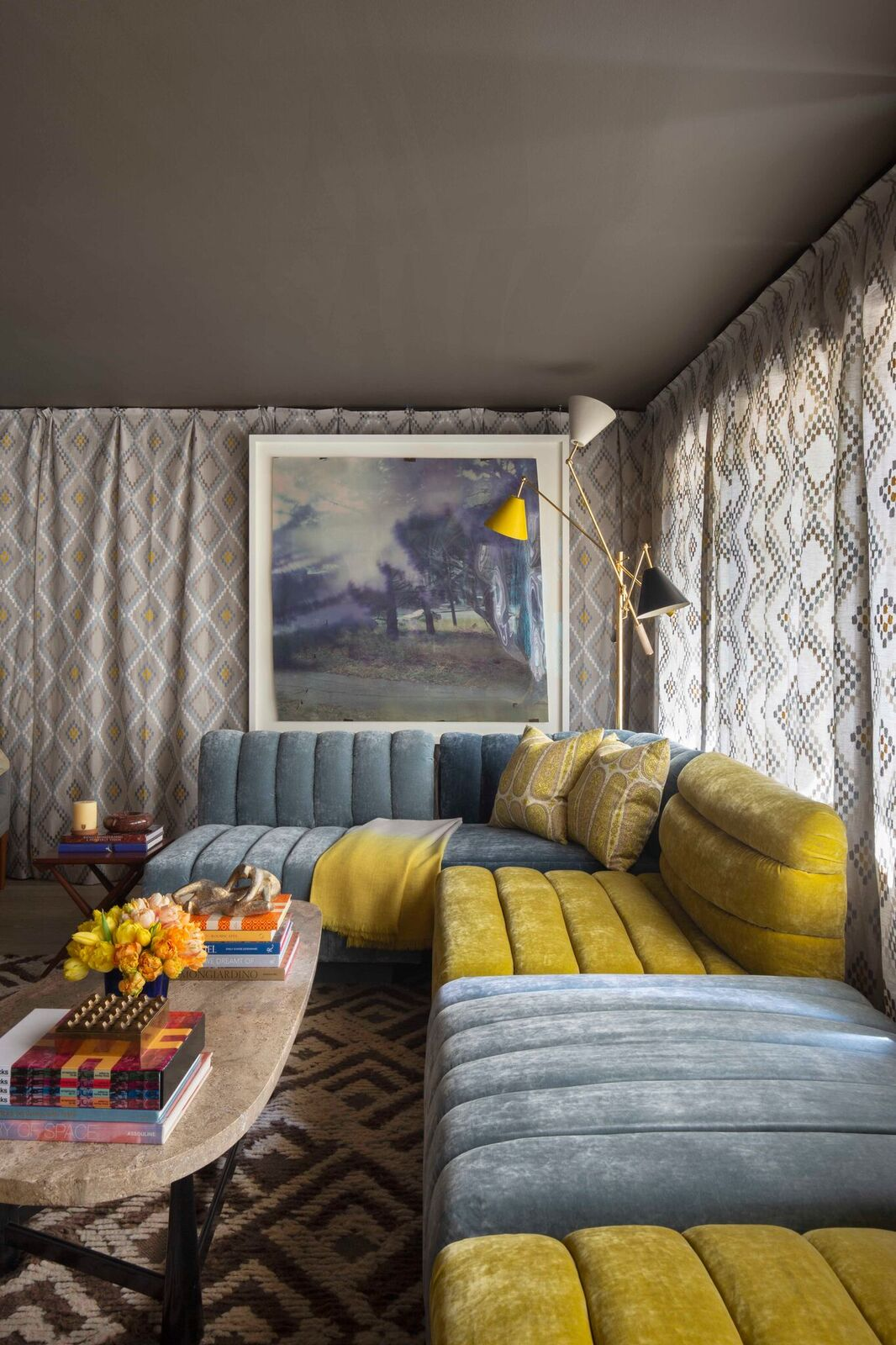 In the Lady Cave, Jon de la Cruz's childhood memories of creating pillow forts were the inspiration. The space is completely draped with embroidered linen fabric, giving the impression of an exotic tent. A custom channel-tufted sectional invites ladies--or anyone else--to sink in and unwind.