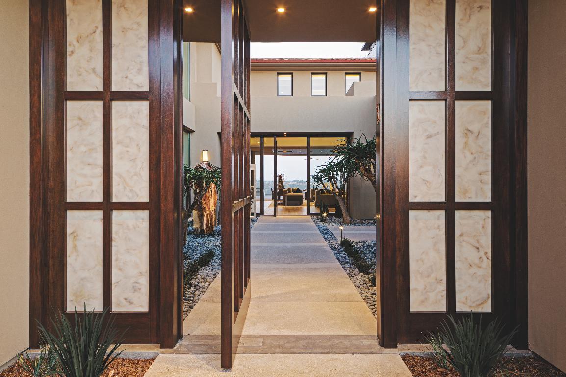 contemporary entry pivot mahogany door