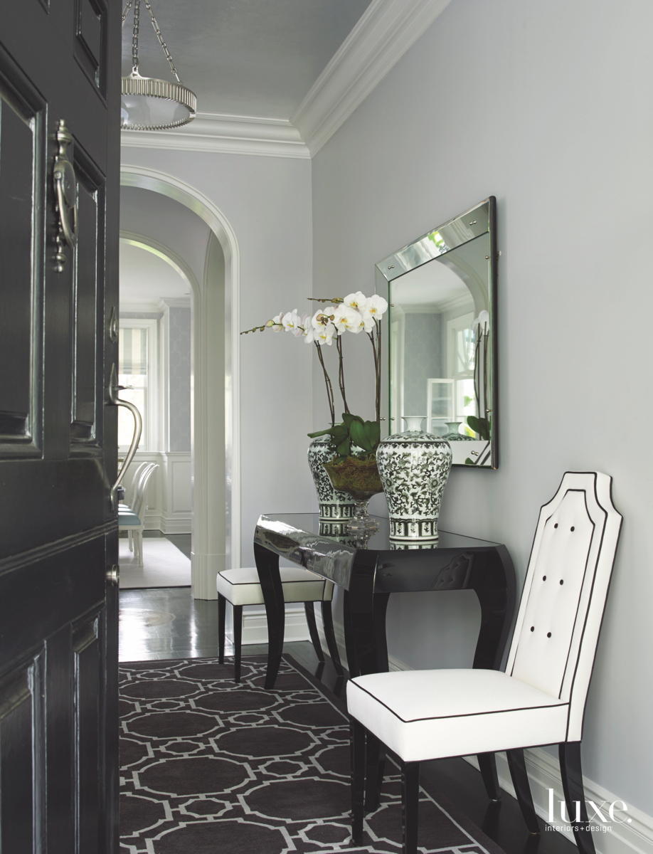 contemporary foyer white chairs mirror