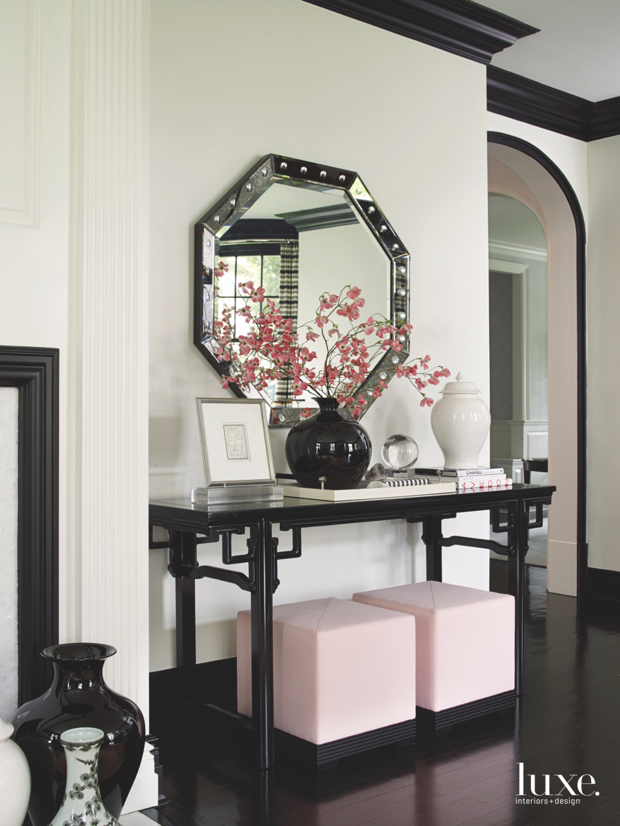 contemporary living room pink ottomans...
