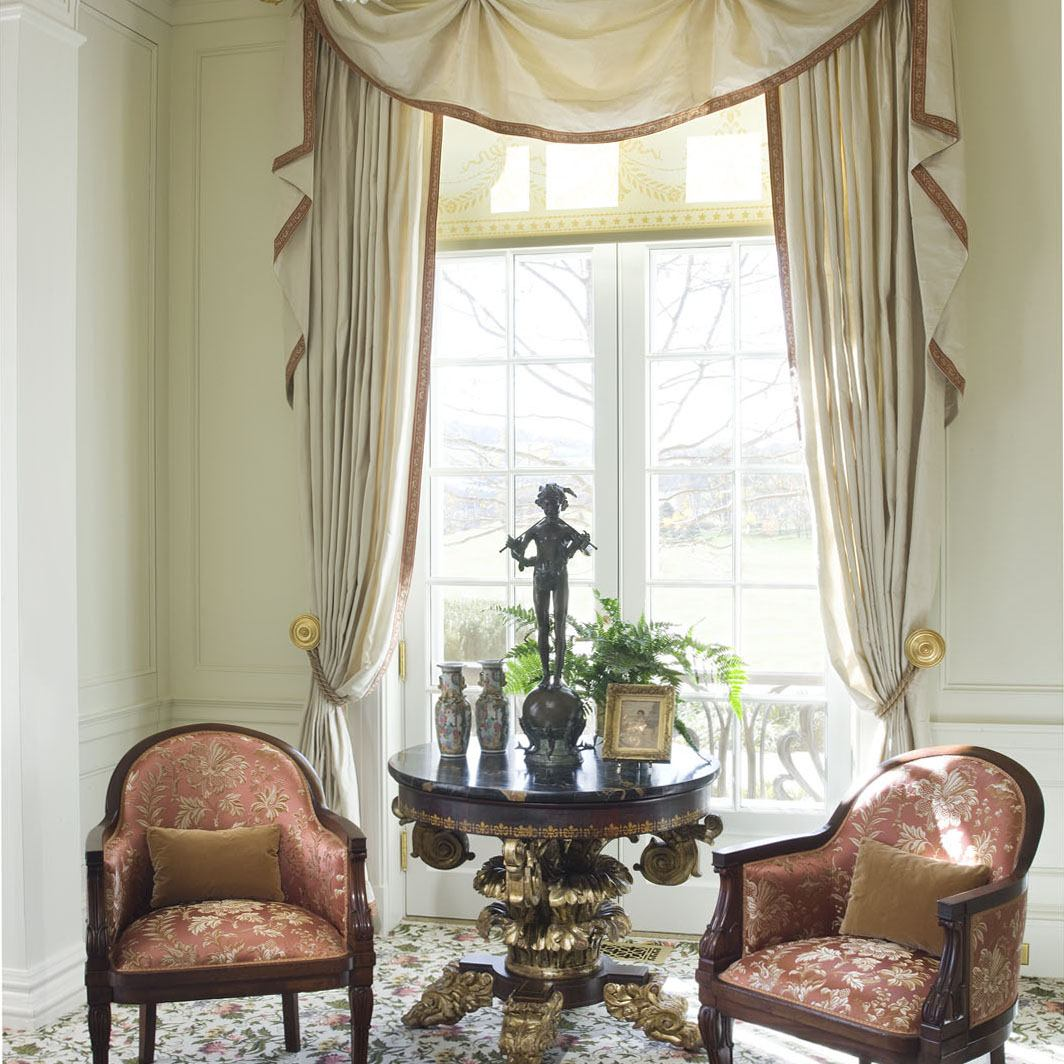 Curtains in the drawing room at Drumlin Hall were inspired by a French design by Ernest Foussier, 1900. The trim was simplified by using a silk tape woven to match the damask upholstery of the chairs.