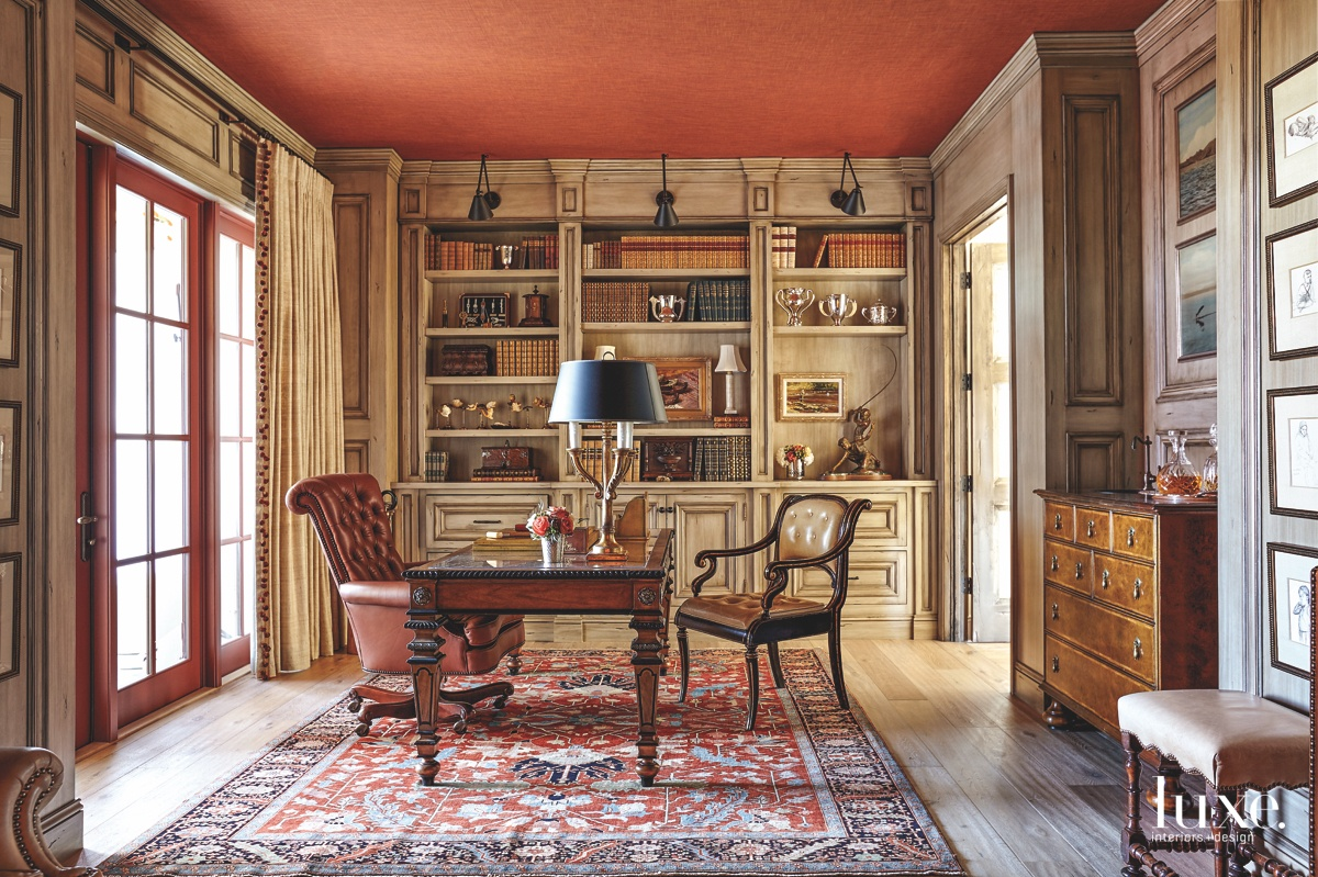 traditional library red accents bookshelves