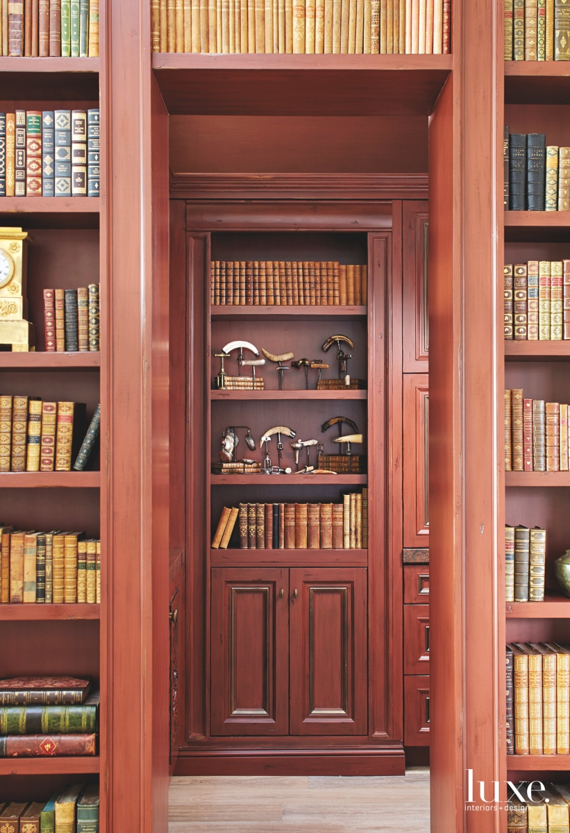 traditional library red accent bookshelves