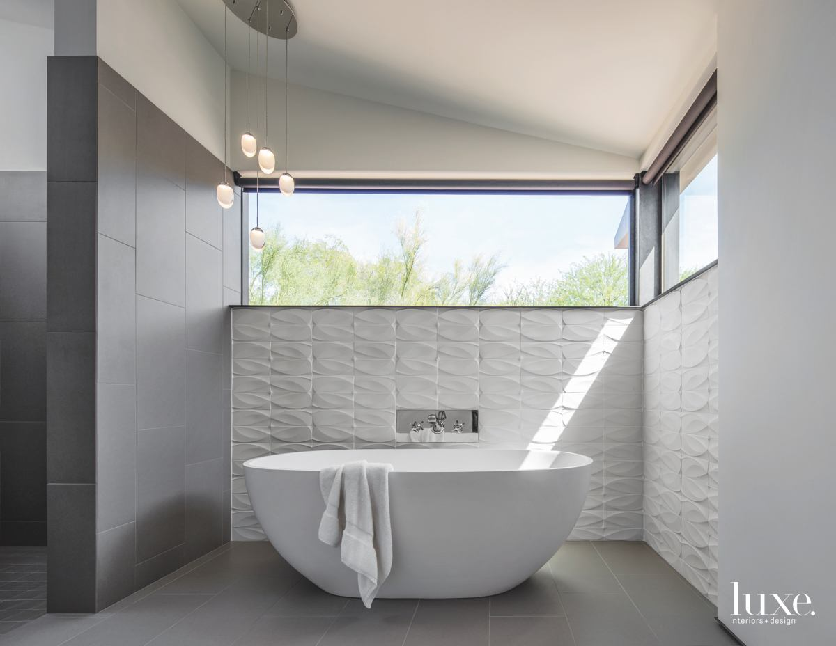 modern white bathroom white freestanding...