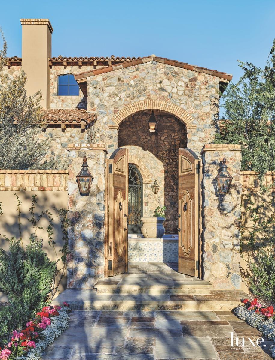 mediterranean exterior neutral entry stonework