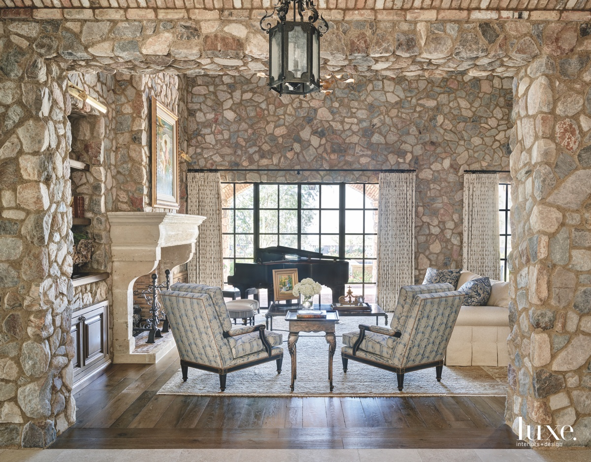 mediterranean great room rustic stonework