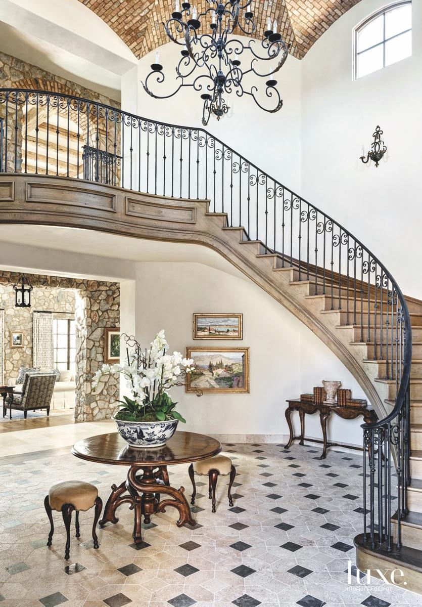 mediterranean foyer staircase brown