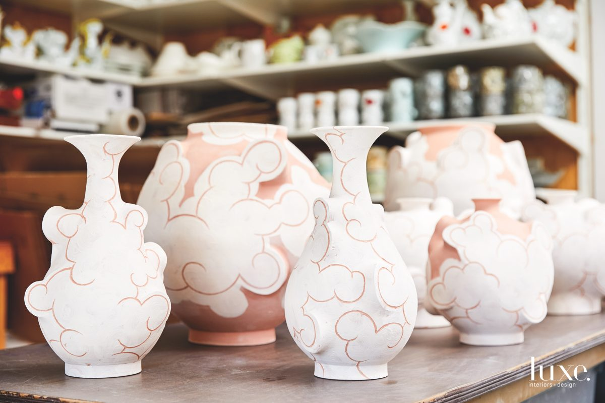 """Bottles in progress for his """"Stoneware Clouds"""" series are fresh out of the bisque firing."""