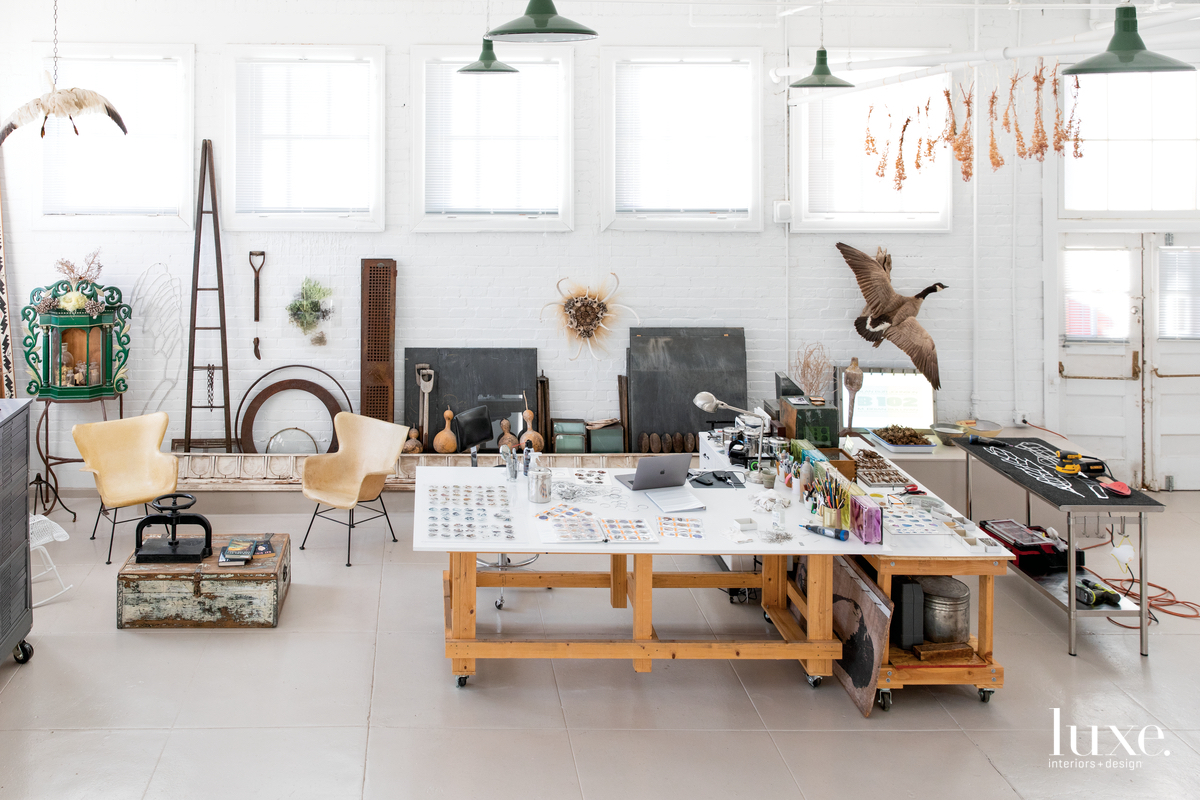 A large work table is the centerpiece of Johnson's light-filled studio, which he furnished with a pair of midcentury fiberglass chairs and a 19th-century nicho from New Mexico.