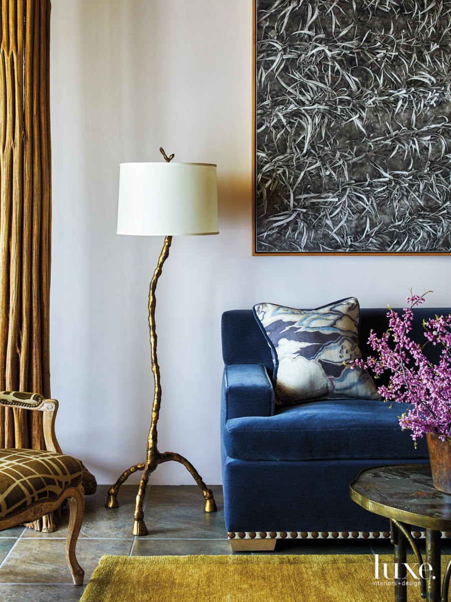 eclectic living room bronze lamp blue velvet sofa