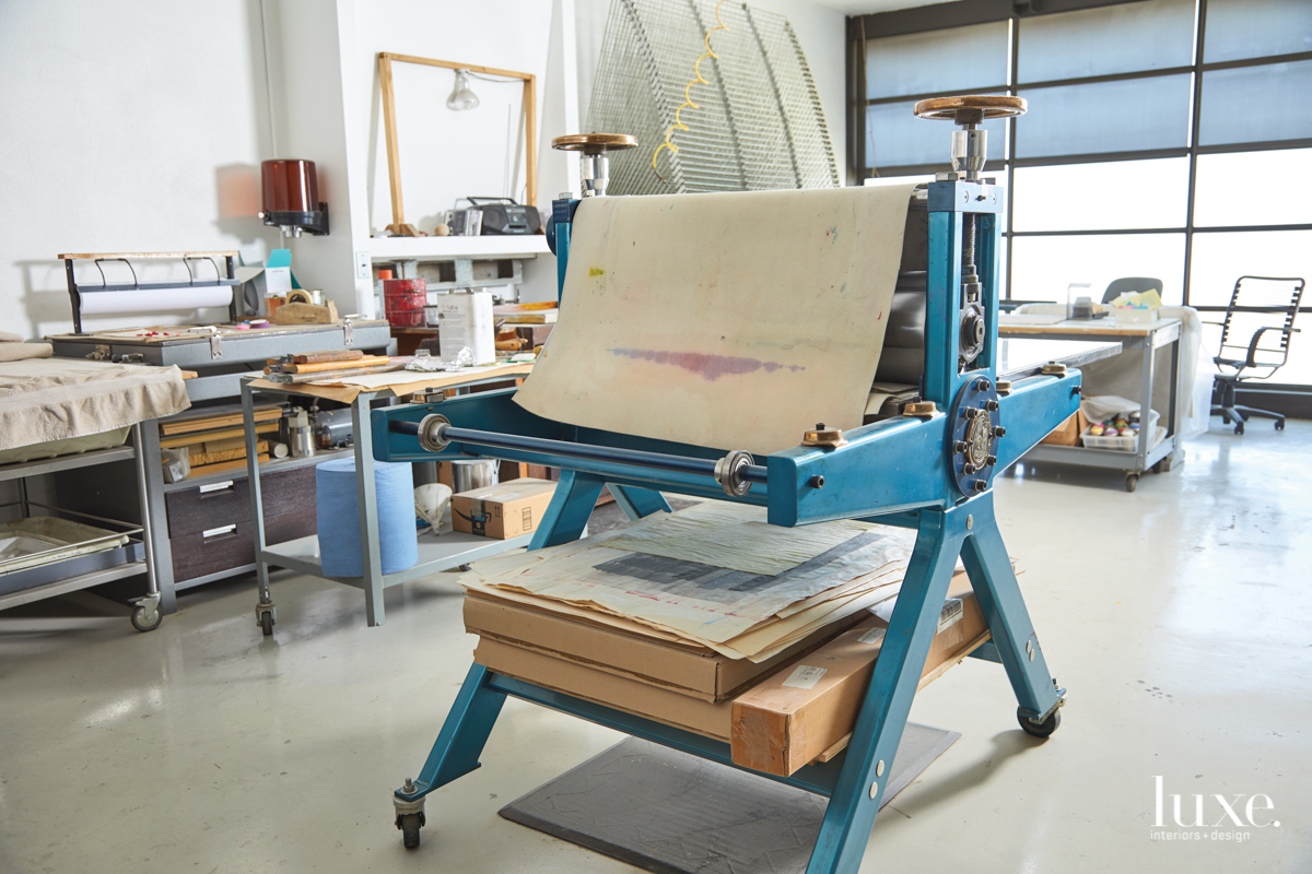 An etching press has pride of place in the studio where Armstrong, a master print maker, works.