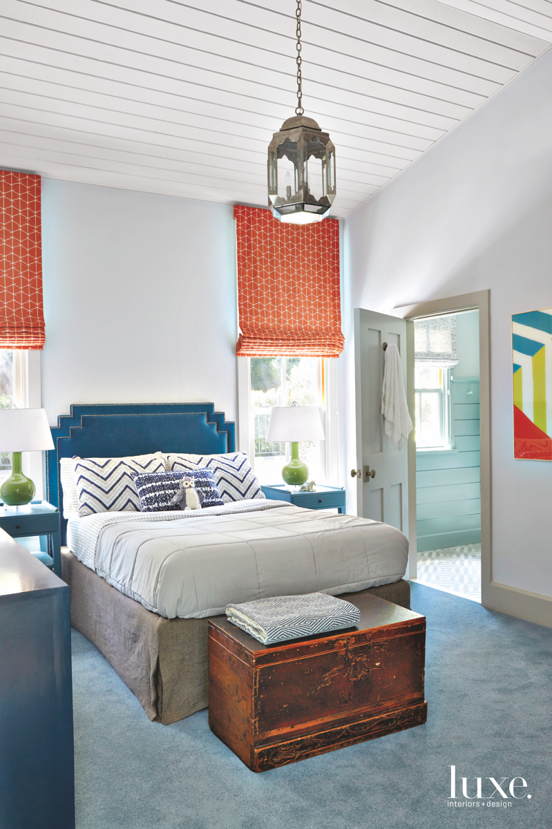 contemporary bedroom blue orange accents