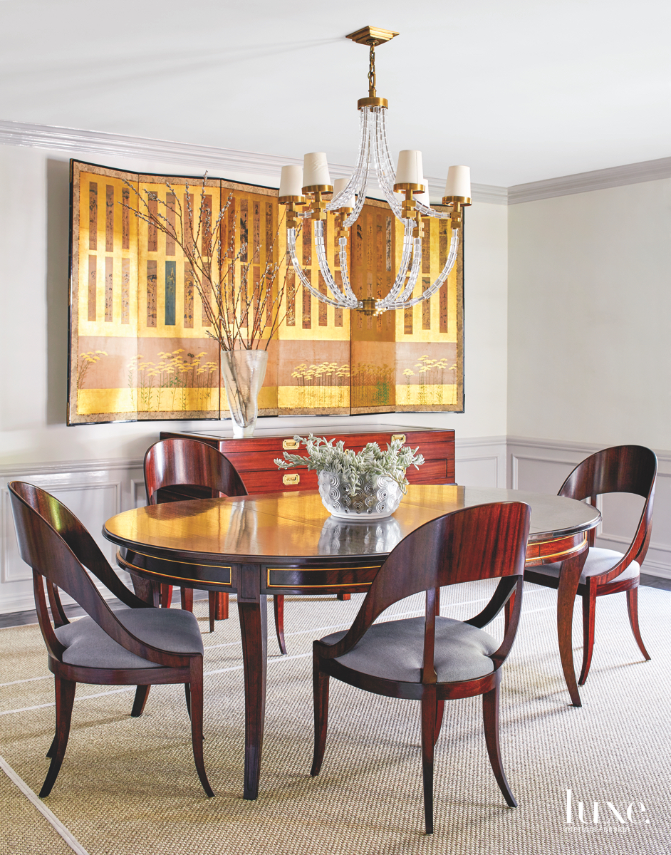 modern dining room gold accents...