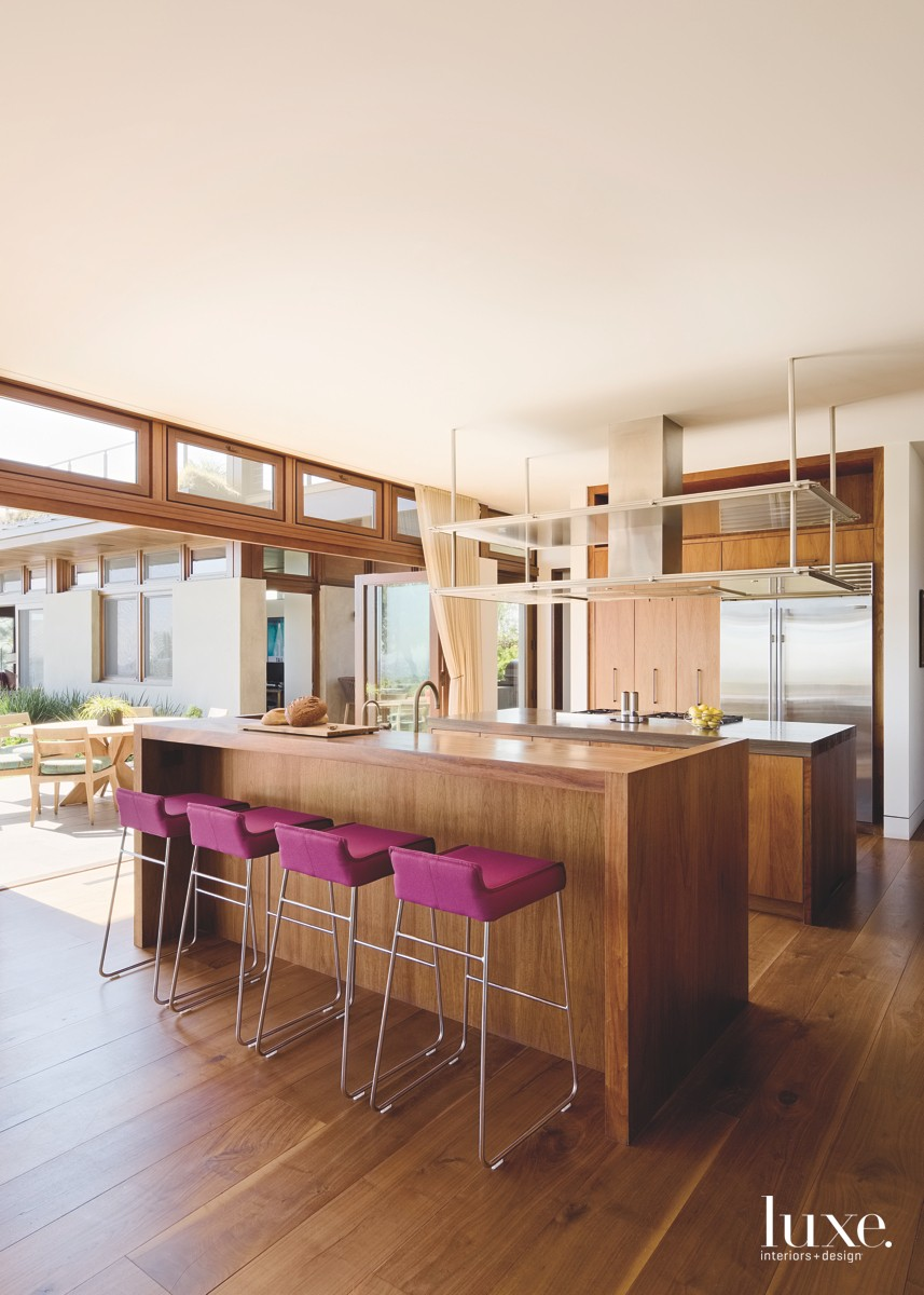 wood kitchen with two islands and chrome counter stools