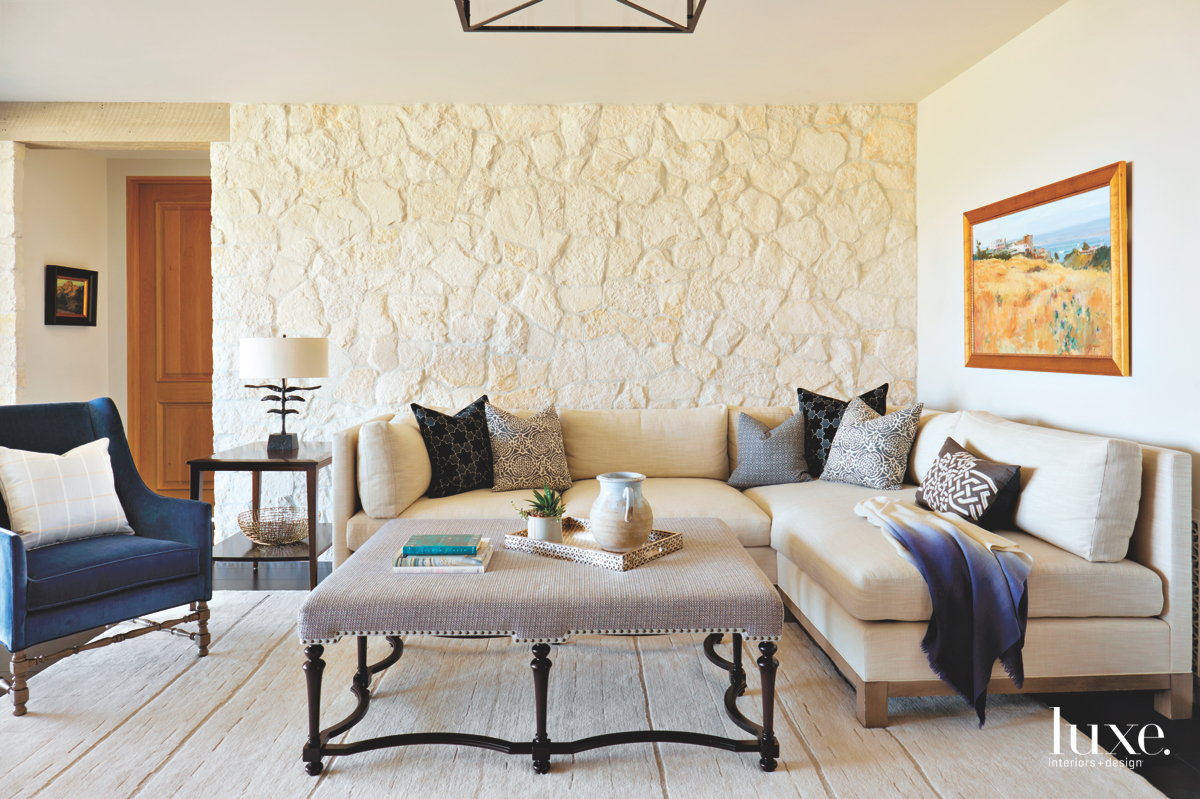 contemporary family room stone wall...