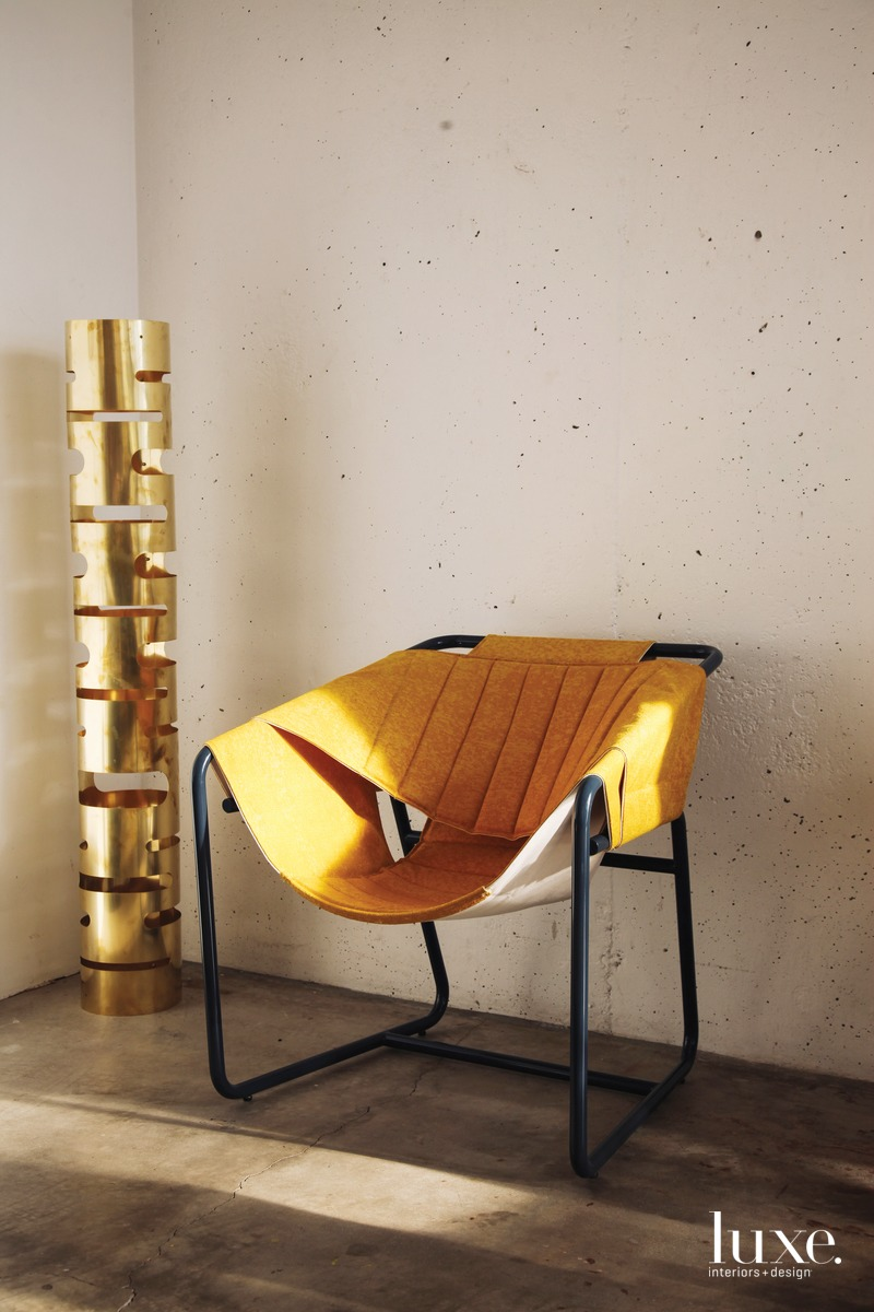 One of his recent commissions includes a metal-and-fabric chair.