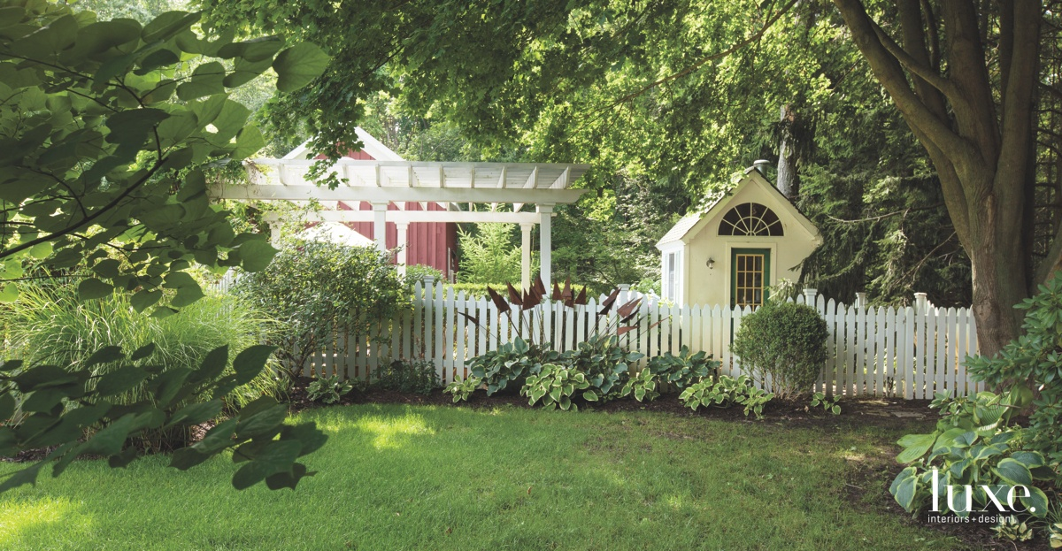 farmhouse exterior white picket fence
