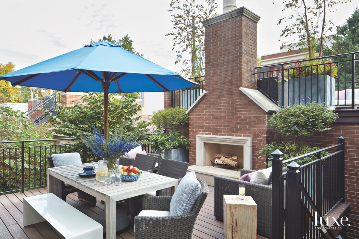 contemporary outdoor dining area fireplace