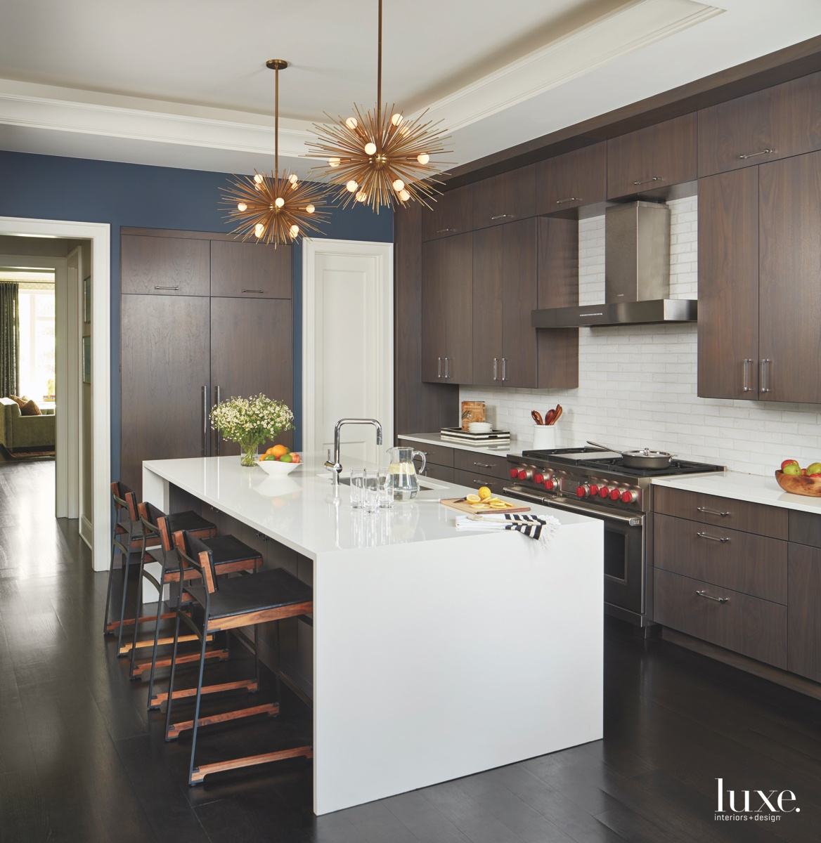 contemporary kitchen brown cabinetry brass...