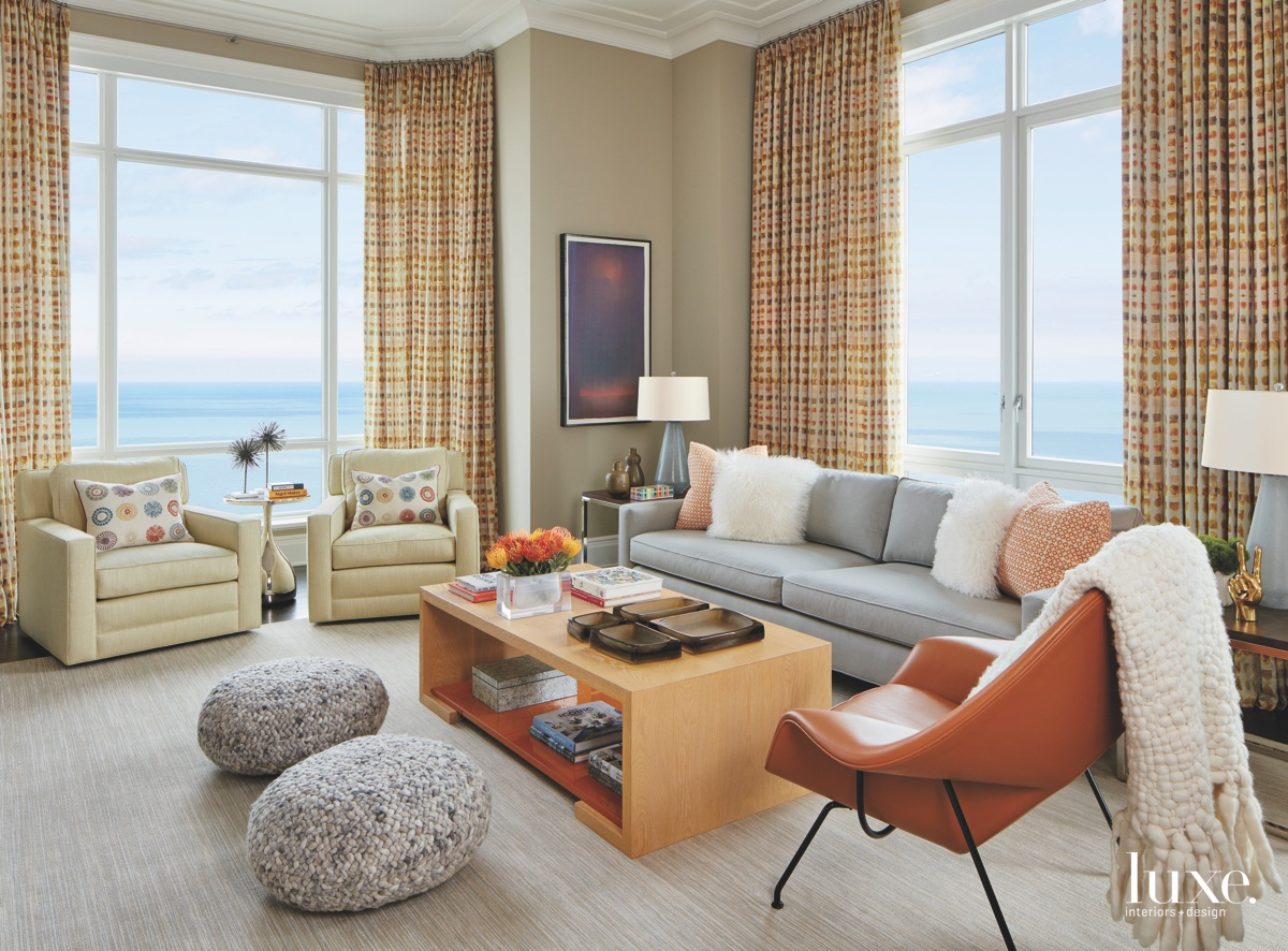 transitional living room neutral orange...