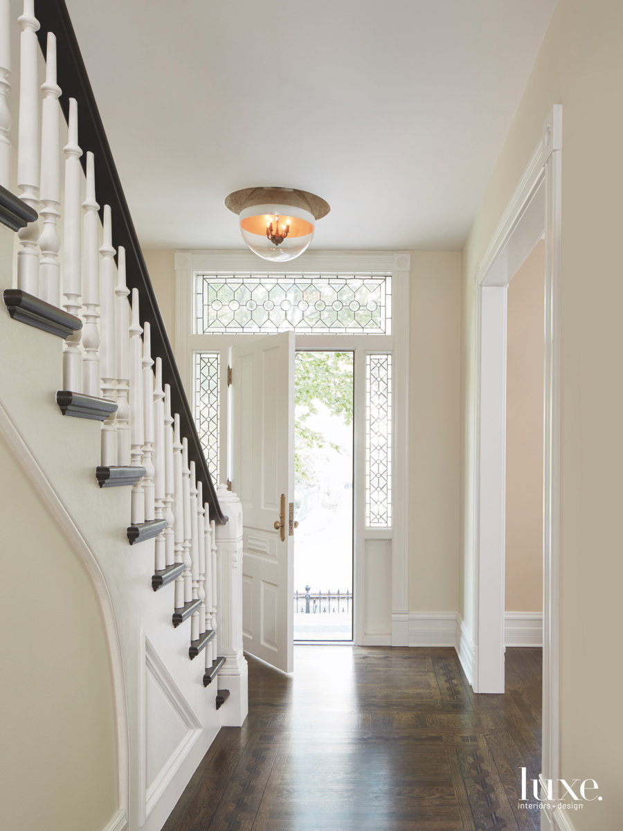 contemporary entry white door neutral...