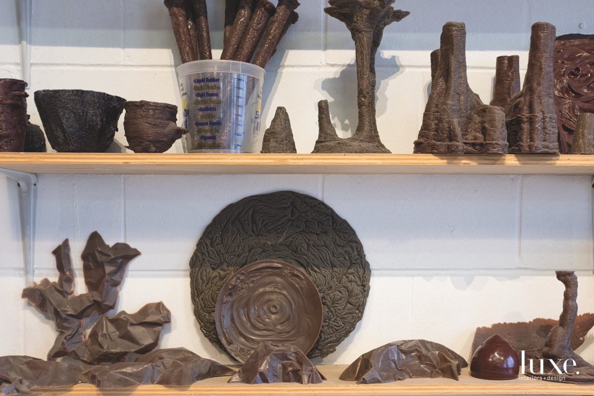 The shelves of his studio are lined with molds.