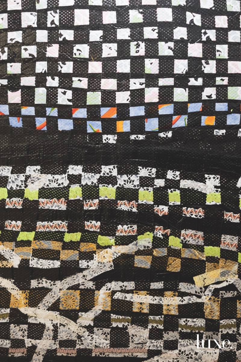 Her mixed-media work Kitchen table_crossword is made of woven plastic, rubber, electrical tape and rickrack, all heat-fused together.