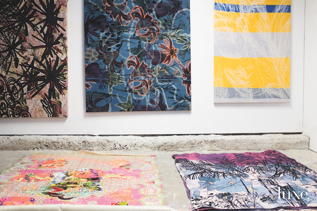 Hanging on a wall (left to right) are the jacquard weavings 136 Fireworks Casa mojada, Wet house and un poco de mi; on the floor are (left to right) Los platos de Sabado and an untitled piece.