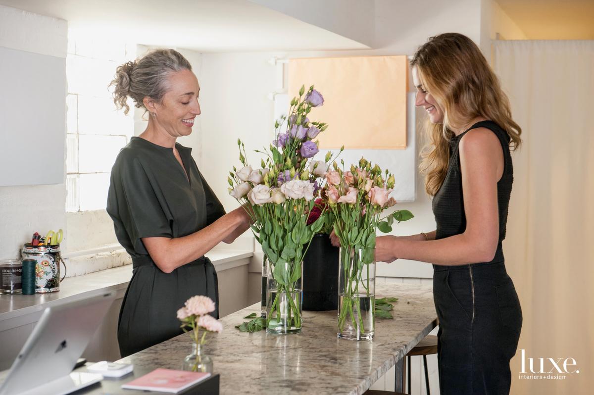 Joynt and Kobelt work on floral arrangements.