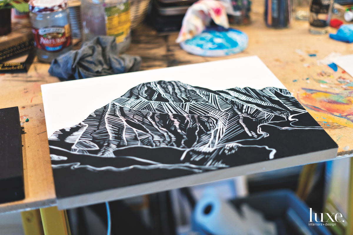 A depiction of Mount Daly is painted in black and white.