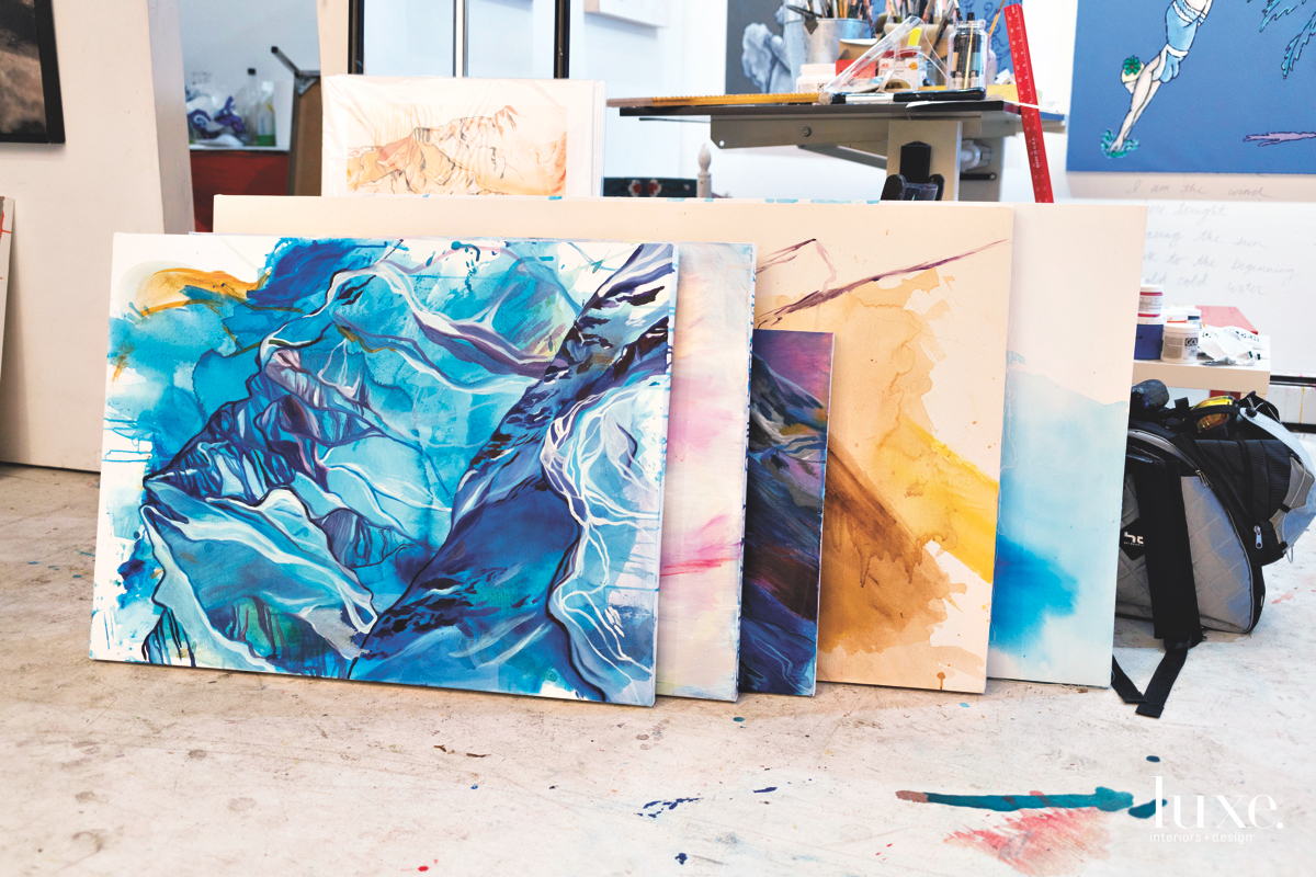 Paintings from her mountain series are rendered in bright hues.