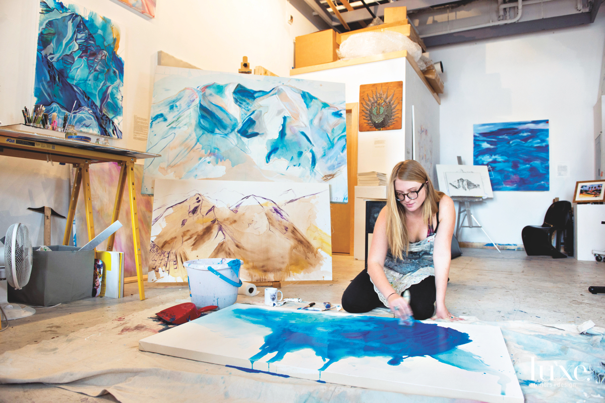 Artist Kelly Peters begins most of her works on the floor to mix the paint and allow it to dry.