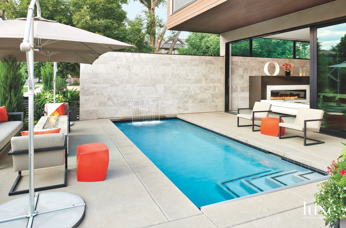 modern outdoor pool and sitting area orange accents