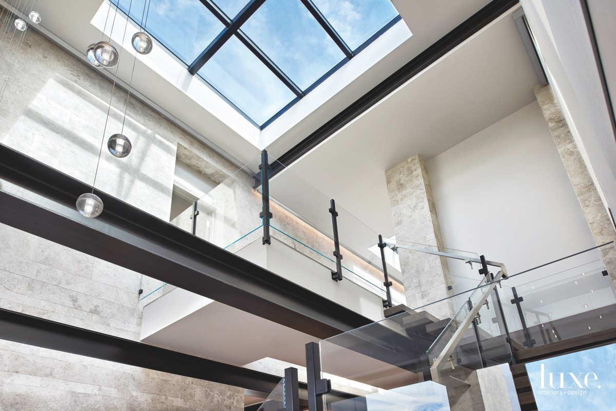 modern glass skylight clear glass railings staircase