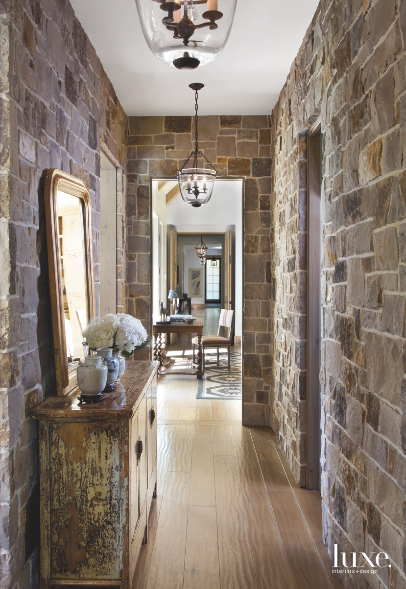 farmhouse hallway sandstone walls mirror