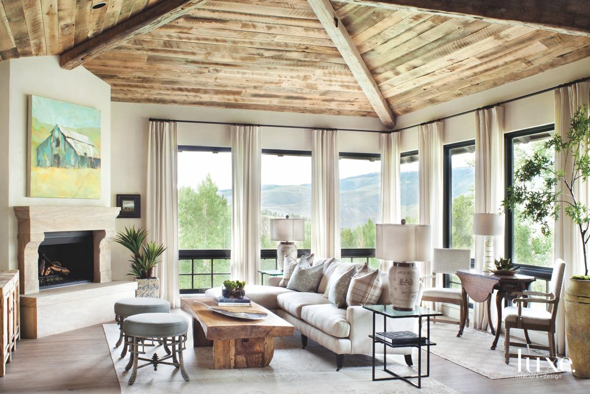 transitional living room limestone fireplace...