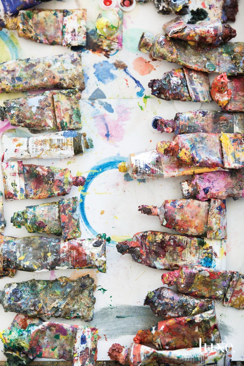 Other studio staples are well-used tubes of oil paint.