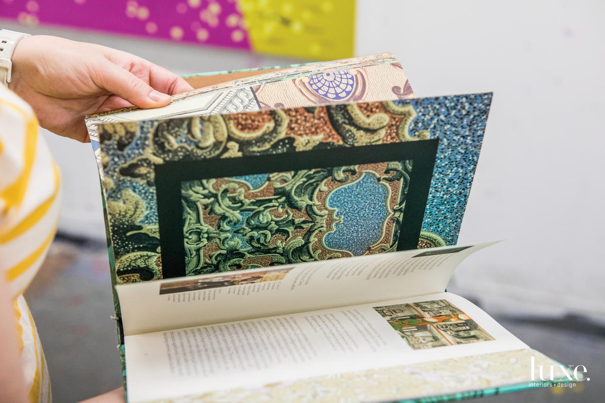 Wallpaper samples provide pattern inspiration.