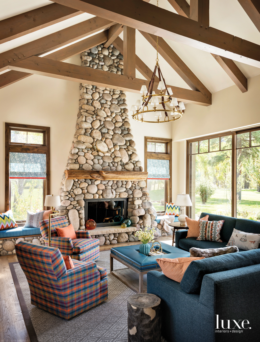 transitional living room blue sectional fireplace