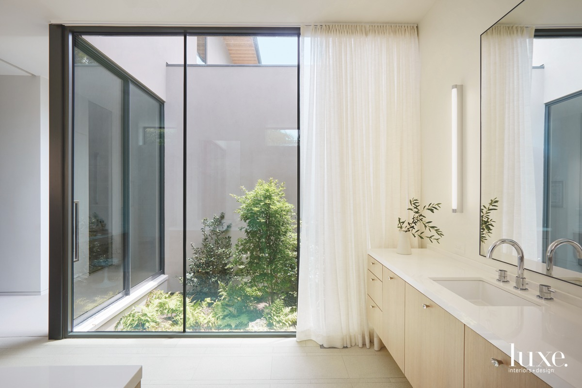 Designer Jean Liu worked with Smitharc Architects to create this minimalistic Dallas oasis, which includes Caesarstone counters, a Graff faucet, a sink by Kohler and Artemide lighting.