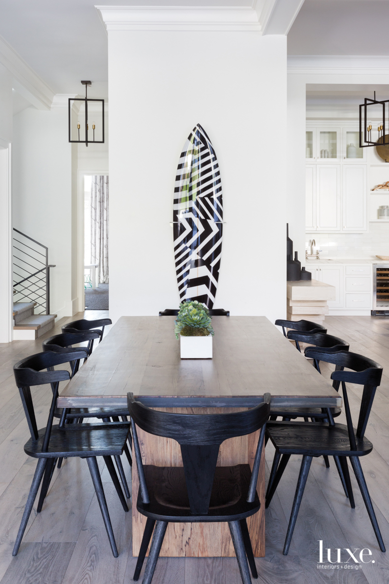 A casual dining area connects...